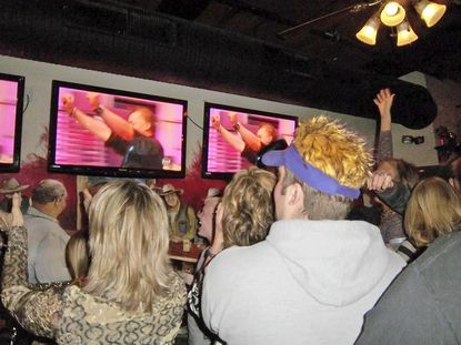 "The crowd at The Dark Horse Saloon goes wild as Jason Hisley and Shelley Stannard of Flavor Cupcakery in Bel Air are announced as winners on an episode of ""Cupcake Wars."""
