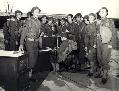 Soldiers from Special Services at Fort Meade during World War II demonstrate the contents of the music kit they assembled and delivered to war zones.