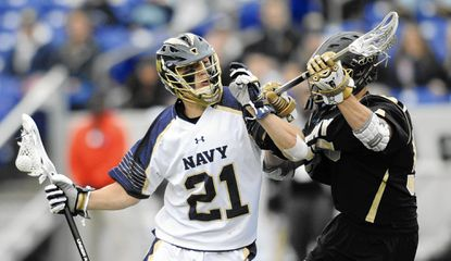 Navy's Casey Rees pushes through Army's Max Krieg during their game in the Patriot League semifinals.