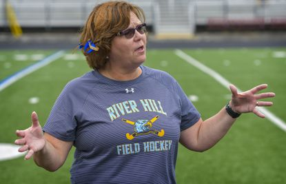 River Hill field hockey coach Shelly Chamness talks to her team during a game against Glenelg in 2018.
