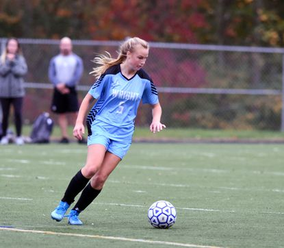 C. Milton Wright's Katie Roszko moves in to make the kick on the loose ball during Tuesday afternoon's regional championship match against Bel Air at C. Milton Wright. Roszko scored the game's lone goal.