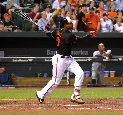 Baltimore Orioles batter Adam Jones hammers a solo home run against Detroit Tigers starting pitcher Justin Verlander to break a scoreless game at Oriole Park at Camden Yards.