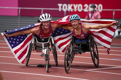 The United States' Susannah Scaroni, right, celebrates after winning the women's 5,000-meter T54 final with third-place teammate Tatyana McFadden during the 2020 Paralympics at the National Stadium in Tokyo on Aug. 28, 2021.