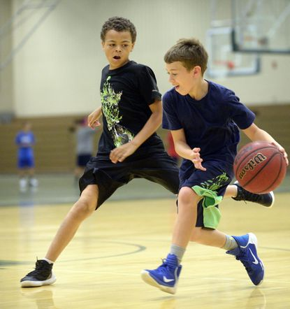 Jayden Smith, 10, and Nick Compher, 9, run drills during Green Terror Basketball Camp at McDaniel College in Westminster Thursday, June 22, 2017.