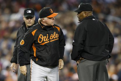 Buck Showalter argues with second base umpire Laz Diaz over a tag play.
