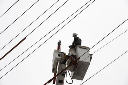 A BGE worker in a bucket works to restore power on Hollingsworth Road near the intersection with Glen Falls Road in Reisterstown.
