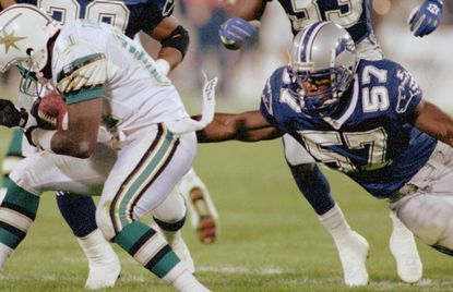 O.J. Brigance (57) played for the Baltimore Stallions of the Canadian Football League in 1994 and 1995. Here, he attempts a tackle against the Sacramento Gold Miners on Sept. 10, 1994.