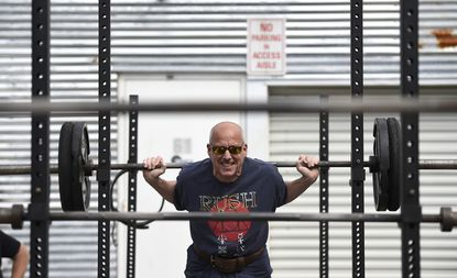 Paul Malla of Sykesville works out at Westminster Strength & Conditioning where exercise equipment has been set up outside to accommodate exercise classes that conform to state and CDC guidelines May 20.