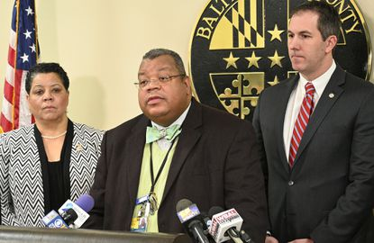 Baltimore County Health Director Dr. Gregory Wm. Branch, center, stands beside County Executive Johnny Olszewski, right, during news conference on the first case of the coronavirus in the county. A county spokesman on Thursday confirmed that Branch has tested positive for COVID-19.