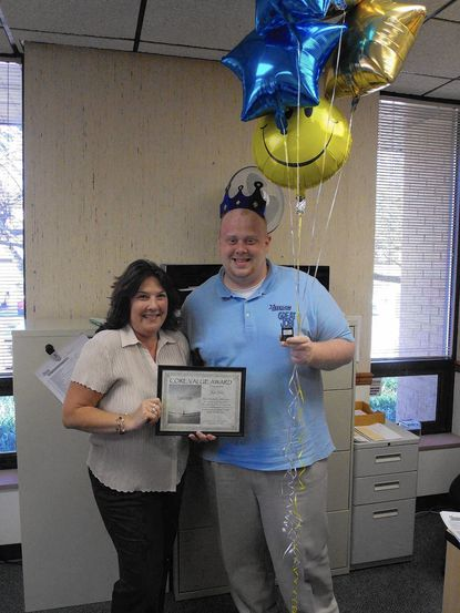 Donna Fisher, left, Freedom's previous winner, presents Joshua Rice with the 2014 third quarter Core Values Award.