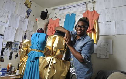 """Baltimore fashion designer and """"Project Runway' finalist Bishme Cromartie's work will be on display at the Maryland Historical Society."""