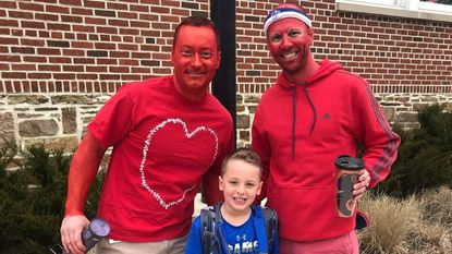 Drew Bove poses with Stoneleigh Elementary School gym teachers Matt Berkey, left, and Tim Lane. They painted themselves red for this year's Kid's Heart Challenge celebration. The school raised more than 150 percent of its goal and Drew garnered more than $9,000.