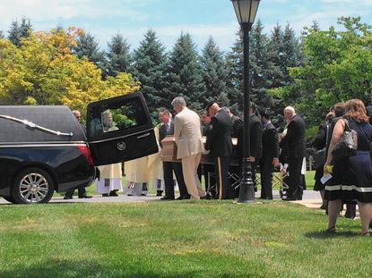 Family and friends attended the funeral for radio personality Thomas Marr on Friday at St. Joseph's Catholic Church.