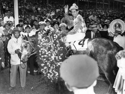 Jockey Eric Guerin and Native Dancer in winner's circle after the 1953 Preakness Stakes. Native Dancer becomes the first horse inducted into the state's athletic hall of fame.