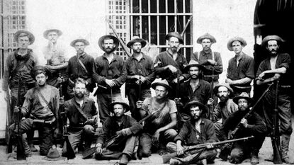 This tough-looking group of soldiers who fought in the Philippine Insurrection includes Sterling Archibald Galt of Taneytown, seated third from the left.