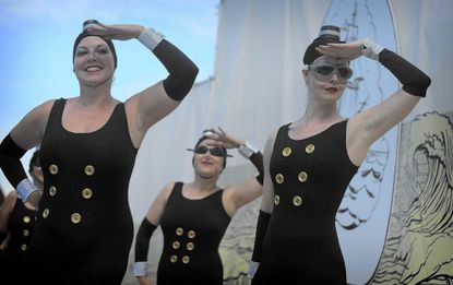 Members of Fluid Movement take part in the12th annual Water Ballet Spectacular in 2013.