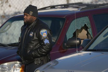 Baltimore Police investigate the shooting scene at Wilgrey Court Wednesday morning.