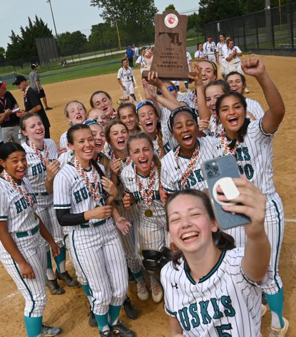 Patterson Mill's Lexi Gresko shoots a few video clips with the championship trophy as she and her teammates celebrate their victory in the 1A state championship softball game against Allegany at Bachman Sports Complex in Glen Burnie Friday, June 18, 2021.