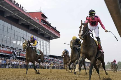 In this May 18, 2019, file photo, jockey Tyler Gaffalione, right, reacts aboard War of Will, as they crosses the finish line first to win the Preakness Stakes horse race at Pimlico Race Course, in Baltimore. The track's ownership recently voiced support for a performance-enhancing diuretic commonly used in racing. (AP Photo/Steve Helber, File)