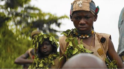 "Idris Elba is outshone by Abraham Attah in ""Beasts of No Nation"""