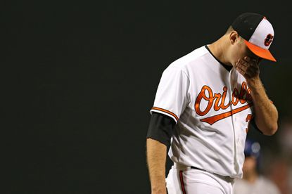 Pitcher Chris Tillman of the Baltimore Orioles is relieved in the seventh inning against the Toronto Blue Jays at Oriole Park at Camden Yards on May 12, 2015 in Baltimore.