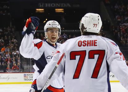 Matt Niskanen of the Washington Capitals celebrates his goal at 1:34 of the third period against the New York Islanders and is joined by T.J. Oshie at the Barclays Center on December 13, 2016.