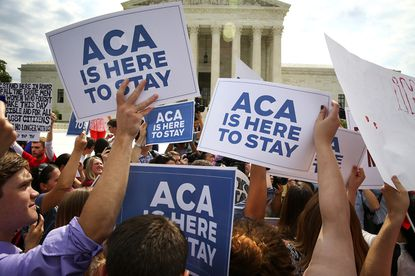 Supporters of the Affordable Care Act outside the Supreme Court in Washington on June 25, 2015.