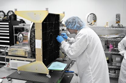 Nathan Young is shown performing the optical performance testing for the CATS telescope.