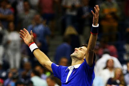 Novak Djokovic celebrates after defeating Roger Federer during their Men's Singles Final match at the US Open.