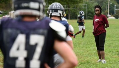 Rayna DuBose, Marriotts Ridge High School assistant varsity football coach who works with the team on mental toughness, at a Tuesday practice. DuBose is a quadruple amputee who is a motivational speaker and will address the Howard County Giving Circle on Oct. 15.