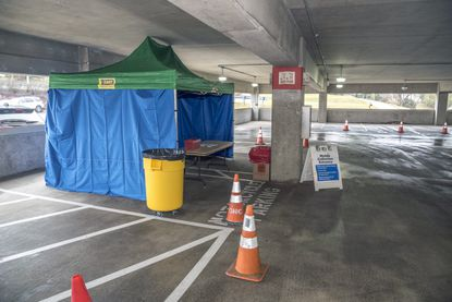 The drive-up testing area at Carroll Hospital is located on the third floor of its parking garage in a section without any other cars.