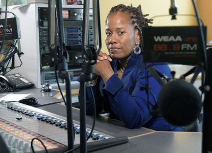 Karsonya (Kaye) Wise Whitehead, Ph.D., is an Associate Professor of Communication and African and African American Studies in the Department of Communication at Loyola University Maryland and the host of Today with Dr. Kaye on WEAA 88.9 FM. Dr. Kaye is in a WEAA studio.