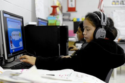 A Florida fifth grader answers a math problem on i-Ready, a diagnostic for math and language arts that pinpoints skills that are lacking. Maryland also uses i-Ready to assess student learning. (Maria Lorenzino/Sun Sentinel)