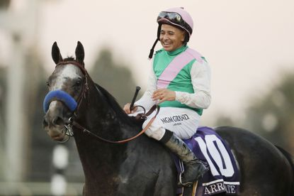 In this Nov. 5, 2016, photo, jockey Mike Smith celebrates after riding Arrogate to victory in the Breeders' Cup Classic horse race at Santa Anita Park in Arcadia, Calif.