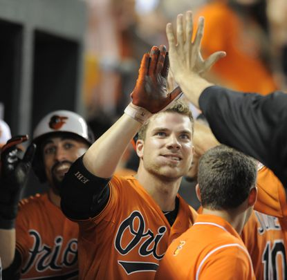 Chris Davis is met in the dugout after his second homer of the game (and 30th of the season).