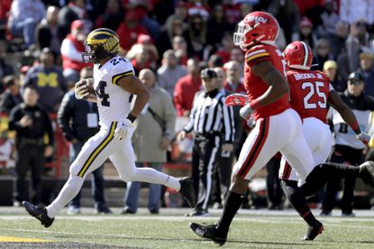 Michigan running back Zach Charbonnet scores a touchdown on a run against Maryland during the first half of an NCAA college football game, Saturday, Nov. 2, 2019, in College Park, Md. (AP Photo/Julio Cortez)