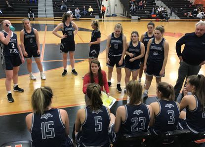 Marriotts Ridge girls basketball coach Sarah Miller talks to her team during a timeout of its 55-47 win at Oakland Mills on Wednesday, Jan. 29, 2020.