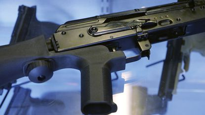 """A device called a """"bump stock"""" is attached to a semi-automatic rifle at the Gun Vault store and shooting range in South Jordan, Utah. Top Democrats in the Maryland General Assembly want to expand the state's assault weapons ban to forbid the sale of bump stocks."""