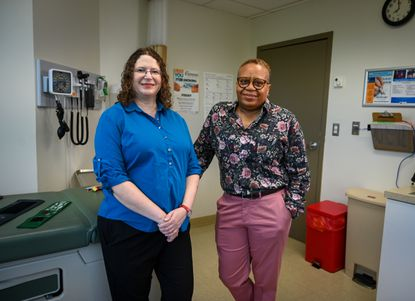 Dr. Elyse Pine (left) and physician assistant Deb Dunn work with young transgender patients at Chase Brexton Health Care. Pine and Dunn share an office and have thrown themselves into making sure their patients receive essential care despite the isolation and anxiety created by COVID-19.