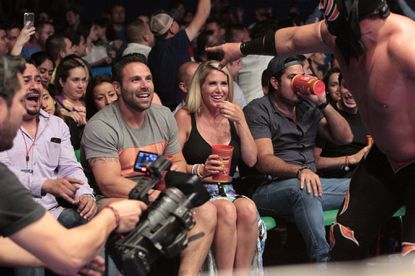 """Mikey T. (left) and Juelia watch wrestling in Mexico on """"Bachelor in Paradise."""""""