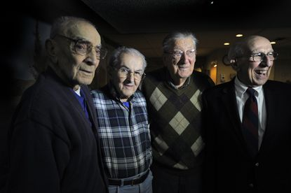 WWII infantry veterans, left to right, Cpl. Michael J. Romanelli, M/Sgt George E. Turner, Jr., Sgt. Paul Guntzel and Staff Sgt. Alfonso A. Roberty, were recently inducted into the Order of Saint Maurice.