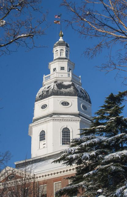 The Maryland State House in downtown Annapolis had a coating of snow on its roof Friday morning.