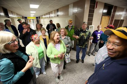Principal Dwayne Jones, right, leads members from Laurel High School's Class of 1971 on a tour through Laurel High School as a part of their 40th reunion in Laurel on Saturday, Sept. 17.