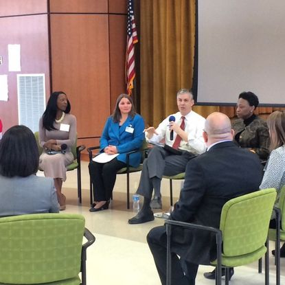 U.S. Secretary of Education Arne Duncan, center, speaks with educators at Ducketts Lane Elementary School Wednesday.