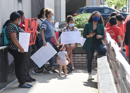 """Advocates at the rally held signs up urging Republican Gov. Larry Hogan to """"cancel rent."""" Maryland renters and families facing the threat of eviction and accumulation of debt are ringing alarm bells about the impending eviction crisis once courts resume evictions on July 25. 07-01-20"""