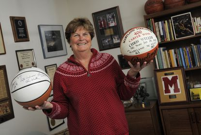 Former Maryland women's basketball coach Chris Weller poses with memorabilia in her Silver Spring home earlier this week. She'll be honored with a banner at Xfinity Center on Sunday.