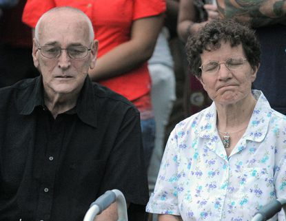 Joseph Ulrich Sr. and Rose Ulrich attend a vigil in Mount Vernon for their son, Alex Ulrich, who was killed last week in a double shooting in Mid-Town, and Larry Peterson, who was critically injured.