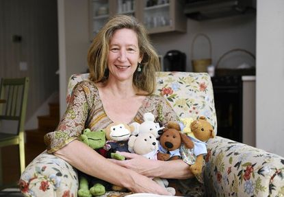 Susan Magsamen, CEO and founder of Curiosityville, a new online learning website for children ages 3-8, holds some of the website's characters.