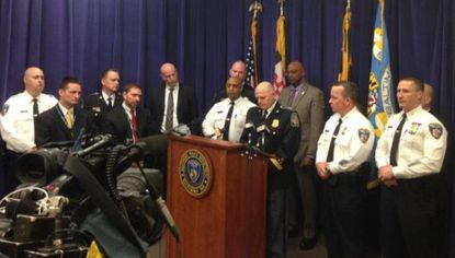 """Local law enforcement officials announce the arrest of a suspect in a string of """"serial"""" robberies involving some 30 businesses."""