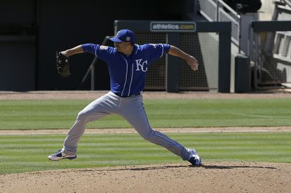 Kansas City Royals relief pitcher Brian Duensing throws against the Oakland Athletics during a spring training baseball game in Mesa, Ariz., Sunday, March 27, 2016.